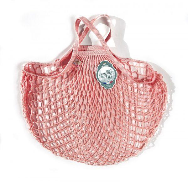 sac filet couleur rose layette sur fond blanc pour le petit je ne sais quoi